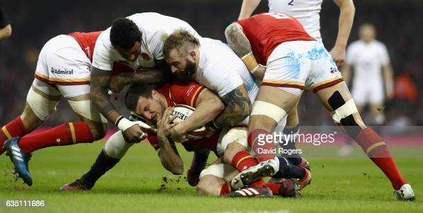 Sam Warburton of Wales is tackled by Courtney Lawes and Joe Marler during the RBS Six Nations match between Wales and England at the Principality...
