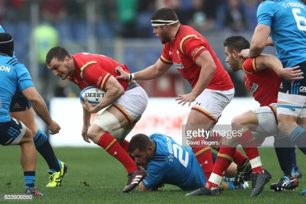 Sam Warburton of Wales is tackled by Ornel Gega of Italy during the RBS Six Nations match between Italy and Wales at the Stadio Olimpico on February...
