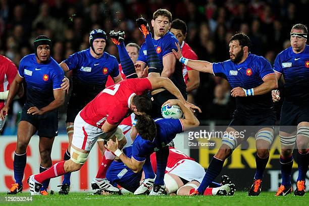 Sam Warburton of Wales upends wing Vincent Clerc of France during semi final one of the 2011 IRB Rugby World Cup between Wales and France at Eden...