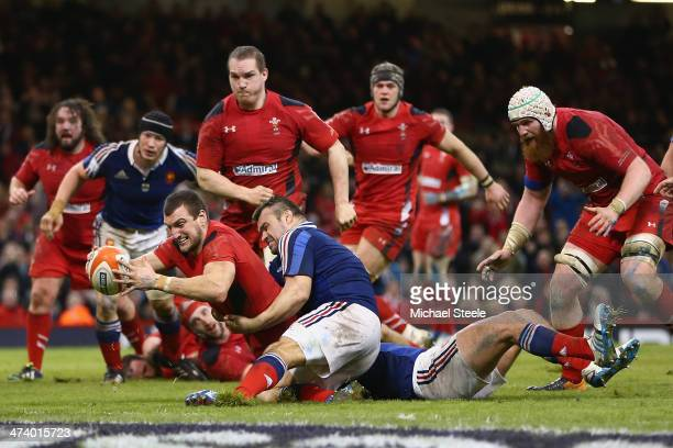 Sam Warburton of Walesscores a try as Nicolas Mas of fails to hold him up during the RBS Six Nations match between Wales and France at the Millennium...