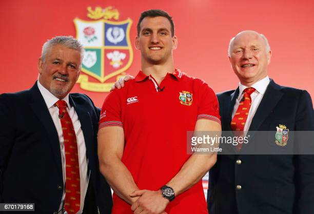 Sam Warburton poses for the cameras flanked by Warren Gatland and John Spencer during the British and Irish Lions tour squad announcement at the...