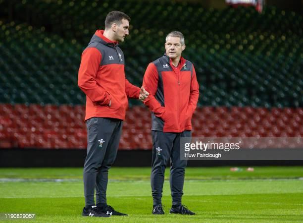 Sam Warburton, Technical Advisor to the Welsh Rugby Team, talks with Byron Hayward defence coach during the Captains run at the Principality Stadium...