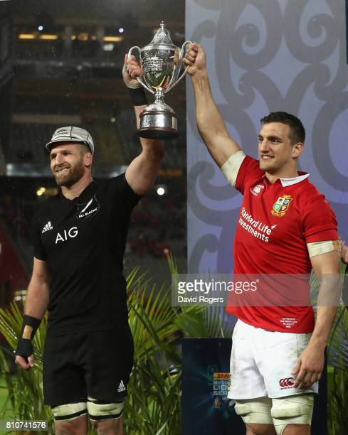 Sam Warburton, the Lions captain, lifts the trophy with Kieran Read, the All Black captain after their sides draw in the final test 15-15 and tie the...