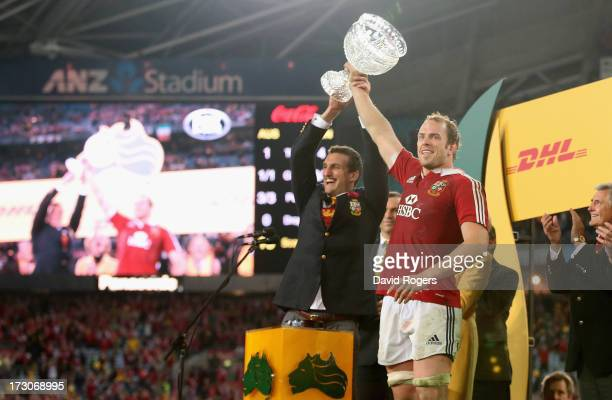 Sam Warburton the Lions tour captain raises the Tom Richards Cup with match captain Alun Wyn Jones after their victory during the International Test...