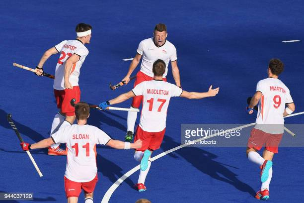 Sam Ward of England celebrates scoring a goal with team mates during the Hockey Men's Pool B match between England and Wales on day six of the Gold...