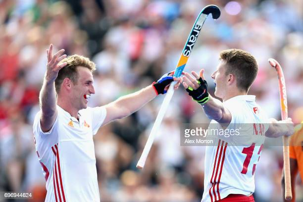 Sam Ward of England celebrates scoring the sixth goal for England with Christopher Griffiths of England during the Hero Hockey World League Semi...