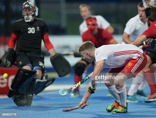 Sam Ward of England scores his teams fourth goal during the quarter final match between England and Canada on day seven of the Hero Hockey World...