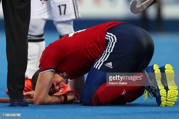 Sam Ward of Great Britain goes down injured after being hit on the head with the ball during the Olympic Qualifier match between Great Britain and...