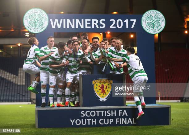 Sam Wardrop of Celtic lifts the trophy during The Scottish FA Youth Cup Final between Celtic and Rangers at Hampden Park on April 26, 2017 in...