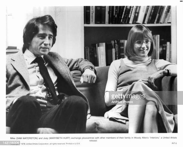 Sam Waterson and Marybeth Hurt exchange pleasantries with family in a scene from the film 'Interiors' 1978
