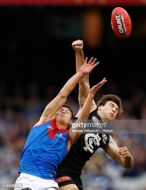 Sam Weideman of the Demons and Caleb Marchbank of the Blues in action during the 2019 AFL round 16 match between the Carlton Blues and the Melbourne...