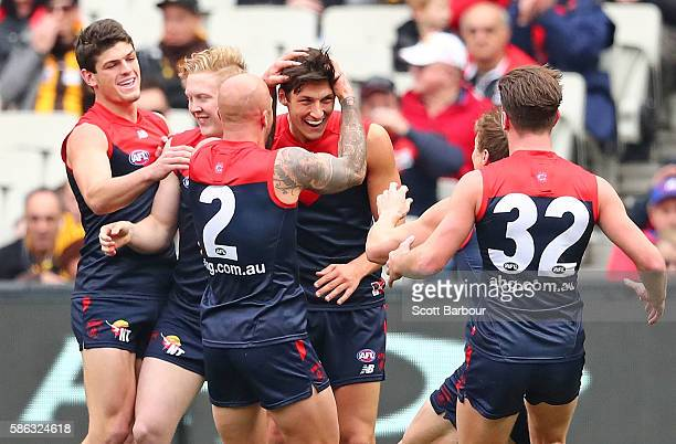 Sam Weideman of the Demons is congratulated by his teammates after kicking a goal after kicking his first goal in the AFL during the round 20 AFL...