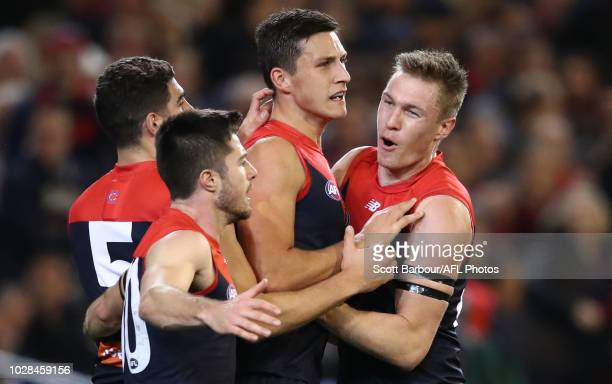 Sam Weideman of the Demons is congratulated by Tom McDonald of the Demons after kicking a goal during the AFL First Elimination Final match between...