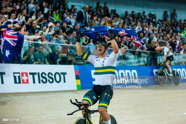 Sam Welsford of the Australian cycling team celebrates with a flag after winning gold in the Men's Team Pursuit final at the Hong Kong Velodrome...