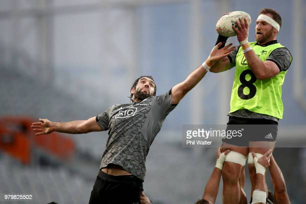 Sam Whitelock and Kieran Read of the All Blacks practice the lineout during a New Zealand All Blacks training session at Forsyth Barr Stadium on June...