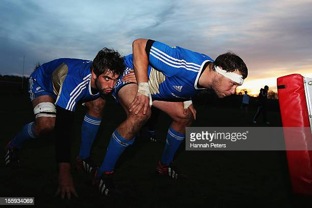 Sam Whitelock and Wyatt Crockett of the All Blacks run through scrum drills during a training session at Peffermill University on November 9 2012 in...