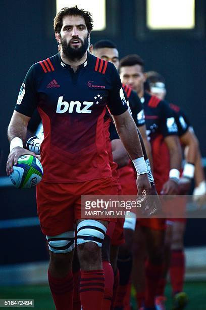 Sam Whitelock captain of the Canterbury Crusaders leads his team onto the field during the Super Rugby match between New Zealand's Canterbury...