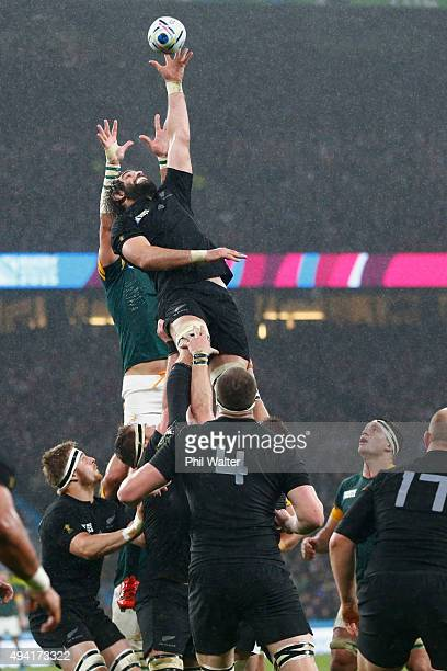 Sam Whitelock of New Zealand steals lineout ball from Victor Matfield of South Aftrica during the 2015 Rugby World Cup Semi Final match between South...