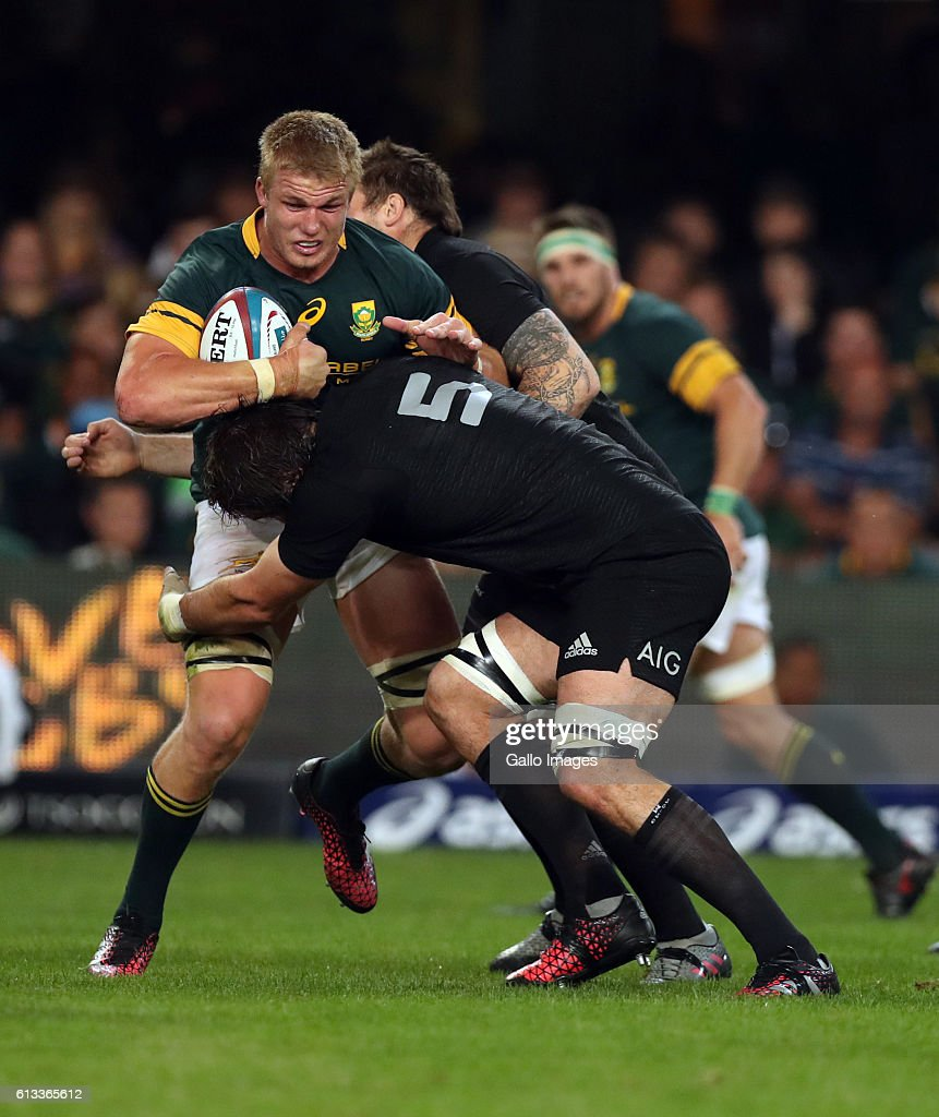 Sam Whitelock of New Zealand tackling Pieter-Steph du Toit of South Africa during the The Rugby Championship match between South Africa and New Zealand at Growthpoint Kings Park on October 08, 2016 in Durban, South Africa.