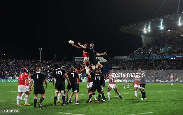 Sam Whitelock of the All Blacks and Michael Leitch of Japan go up for the line out ball during the IRB 2011 Rugby World Cup Pool A match between New...