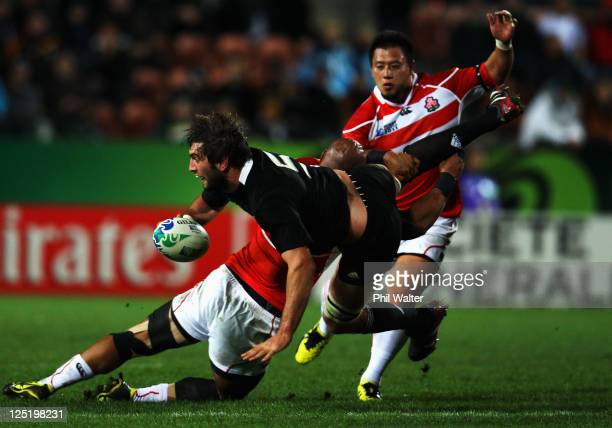 Sam Whitelock of the All Blacks is tackled by Alisi Tupuailai of Japan during the IRB 2011 Rugby World Cup Pool A match between New Zealand and Japan...
