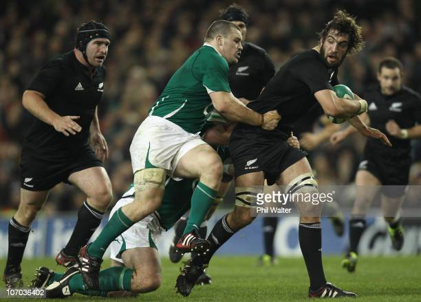 Sam Whitelock of the All Blacks is tackled by Cian Healy of Ireland during the Test match between Ireland and the New Zealand All Blacks at Aviva...