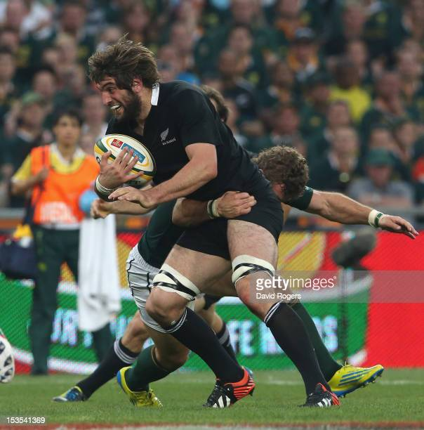 Sam Whitelock of the All Blacks moves past Jaco Taute during the Rugby Championship match between South Africa Springboks and the New Zealand All...