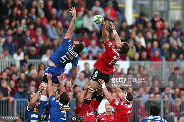 Sam Whitelock of the Cruasders competes with De Kock Steenkamp of the Stormers for line out ball during the round four Super Rugby match between the...