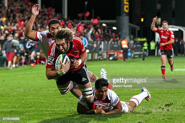 Sam Whitelock of the Crusaders dives over to score a try during the round 13 Super Rugby match between the Crusaders and the Reds at AMI Stadium on...
