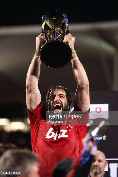 Sam Whitelock of the Crusaders holds up the Super Rugby Trophy following the Super Rugby Final between the Crusaders and the Jaguares at Orangetheory...