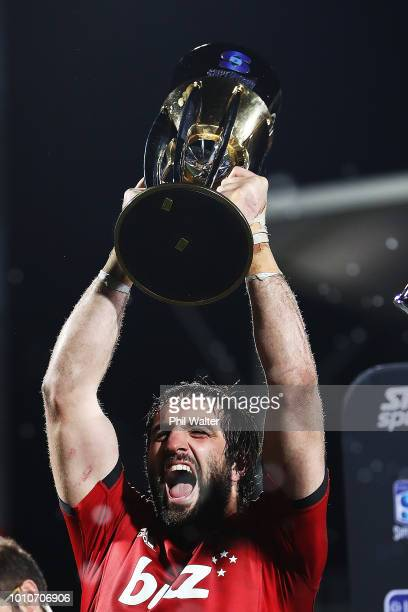 Sam Whitelock of the Crusaders lifts the Super Rugby trophy after winning the Super Rugby Final match between the Crusaders and the Lions at AMI...
