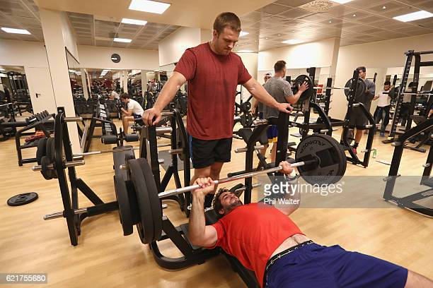 Sam Whitelock of the New Zealand All Blacks exercises with assistance from Sam Cane during a gym session on November 8 2016 in Rome Italy