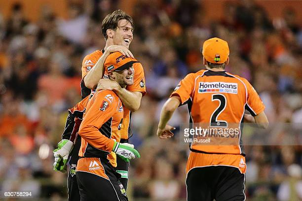 Sam Whiteman of the Scorchers celebrates after running out Pat Cummins of the Thunder during the Big Bash League match between the Perth Scorchers...