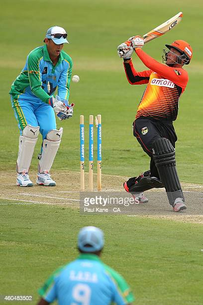 Sam Whiteman of the Scorchers gets bowled by Andrew Symonds of the Legends XI during the Twenty20 match between the Perth Scorchers and Australian...