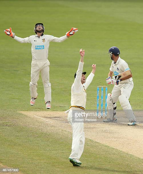 Sam Whiteman of Western Australia celebrates after taking a catch to dismiss Rob Quiney of Victoria off the bowling of Andrew Tye of Western...