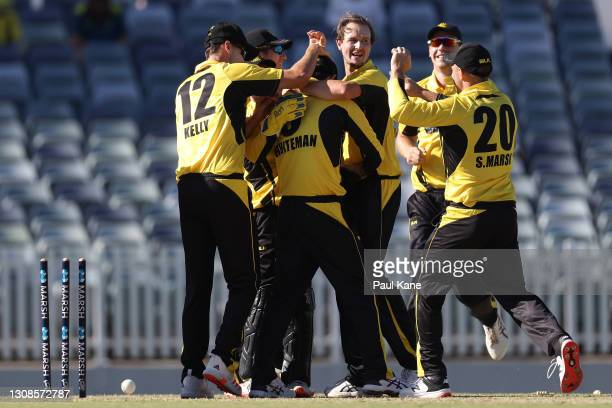 Sam Whiteman of Western Australia is congratulated by team mates after running out Will Sutherland of Victoria during the Marsh One Day Cup match...