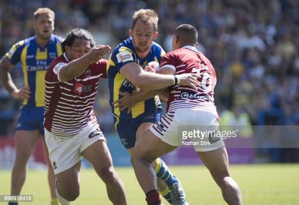 Sam Wilde of Warrington Wolves in action during the Ladbrokes Challenge Cup QuarterFinal match between Warrington Wolves and Wigan Warriors at...