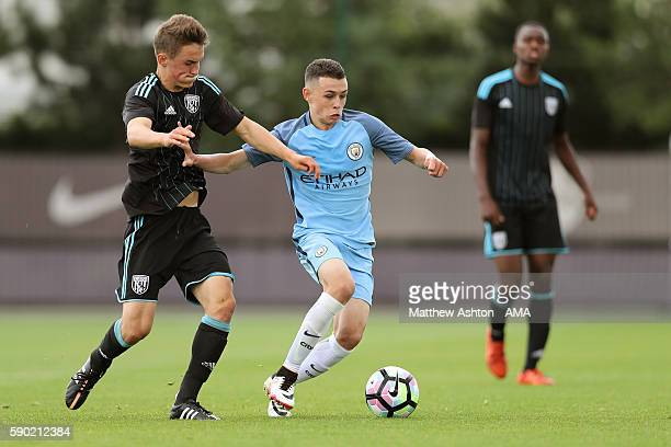 Sam Wilding of West Bromwich Albion U18 and Phil Foden of Manchester City U18 during the U18 Premier League match between Manchester City and West...