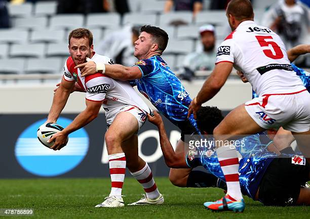 Sam Williams of St George is tackled during the round two NRL match between the New Zealand Warriors and the St George Illawarra Dragons at Eden Park...
