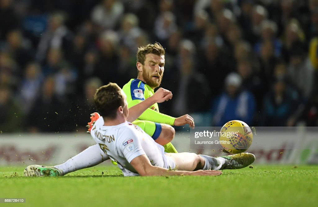 Sam Winall of Derby County battles for the ball with Matthew Pennington of Leeds United during the Sky Bet Championship match between Leeds United and Derby County at Elland Road on October 31, 2017 in Leeds, England.