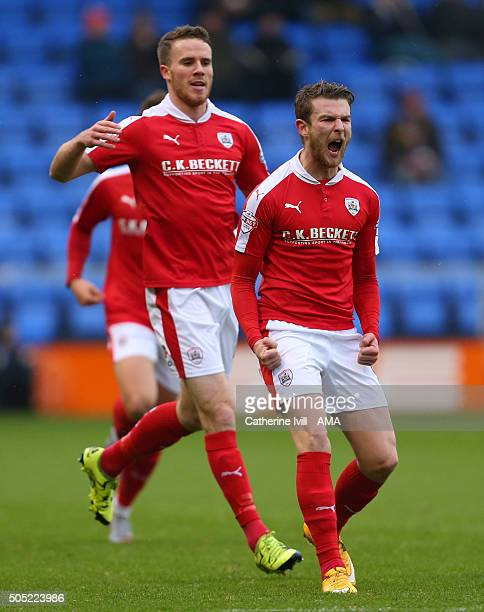 Sam Winnall of Barnsley celebrates after he scores to make it 01 during the Sky Bet League One match between Shrewsbury Town and Barnsley at New...