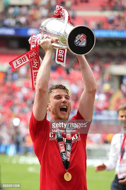 Sam Winnall of Barnsley with the trophy as he celebrates promotion after winning the Sky Bet League One Play Off Final between Barnsley and Millwall...