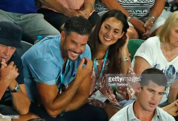 Sam Wood and Snezana Markoski watch the semifinal match between Marin Cilic of Croatia and Kyle Edmund of Great Britain on day 11 of the 2018...