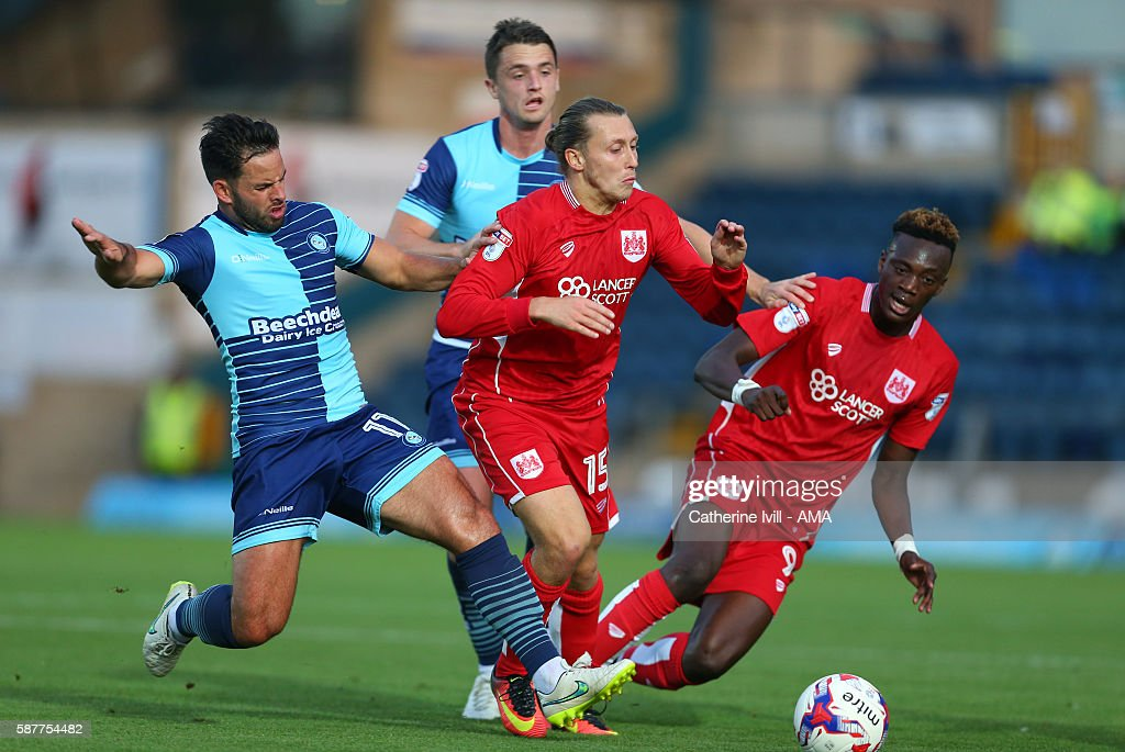 Sam Wood and Stephen McGinn of Wycombe Wanderers battle Luke Freeman and Tammy Abraham of Bristol City during the EFL Cup match between Wycombe Wanderers and Bristol City at Adams Park on August 8, 2016 in High Wycombe, England.