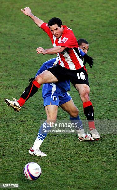 Sam Wood of Brentford and Curtis Weston of Gillingham battle for the ball during the Coca-Cola League Two match between Brentford and Gillingham at...