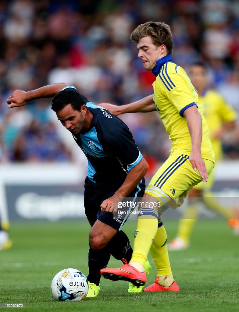 Sam Wood of Wycombe holds off the challenge of Marco van Ginkel of Chelsea duing the pre season friendly match between Wycombe Wanderers and Chelsea at Adams Park on July 16, 2014 in High Wycombe, England.