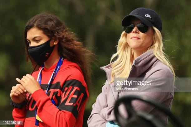 Sam Woods, daughter of Tiger Woods of the United States, and her mother Elin Nordegren look on during the final round of the PNC Championship at the...