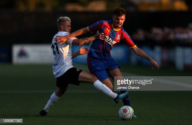 Sam Woods of Crystal Palace is challenged by BobbyJoe Taylor of Bromley FC during the preseason friendly match between Bromley and Crystal Palace on...