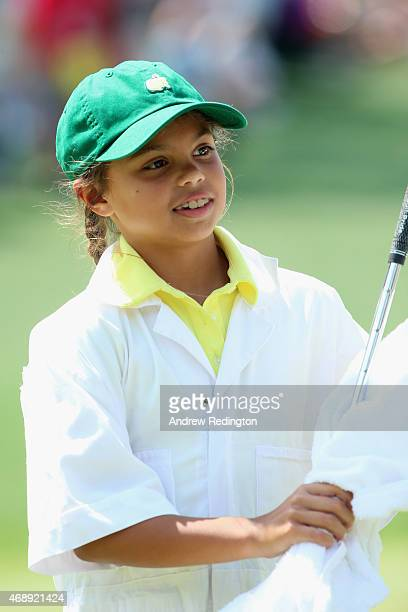 Sam Woods works as a caddie for her father Tiger Woods during the Par 3 Contest prior to the start of the 2015 Masters Tournament at Augusta National...