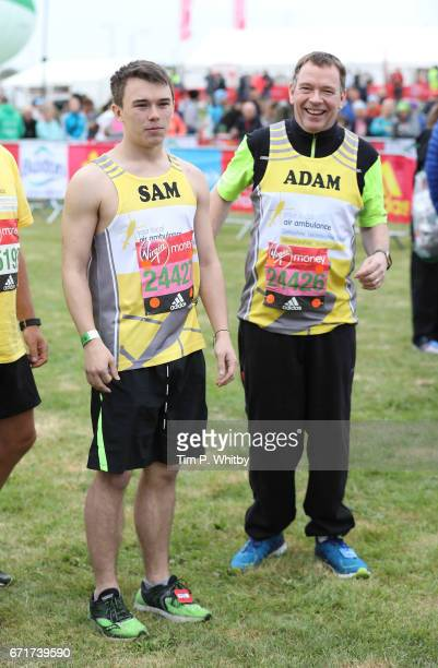 Sam Woodyatt and Adam Woodyatt pose for a photo ahead of participating in The Virgin London Marathon on April 23 2017 in London England